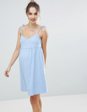 photo Maternity Mini Smock Sundress with Tie Straps by ASOS DESIGN, color Chambray Blue - Image 1