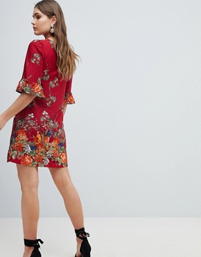 photo Frill Sleeve Shift Dress in Floral Border Print by Yumi, color Red - Image 2