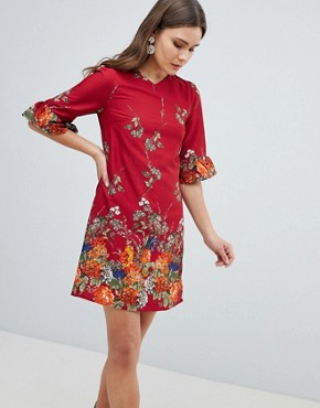 photo Frill Sleeve Shift Dress in Floral Border Print by Yumi, color Red - Image 1