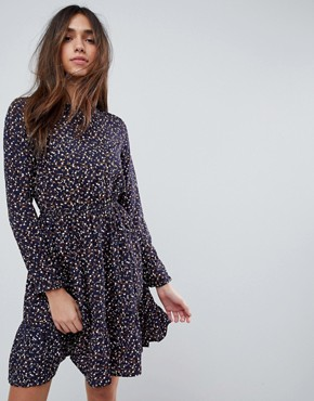 photo Long Sleeve Tea Dress in Ditsy Floral by Yumi, color Navy - Image 1