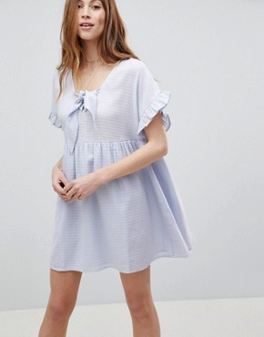 photo Casual Mini Smock Dress in Grid Texture with Bunny Tie by ASOS, color Pale Blue - Image 1
