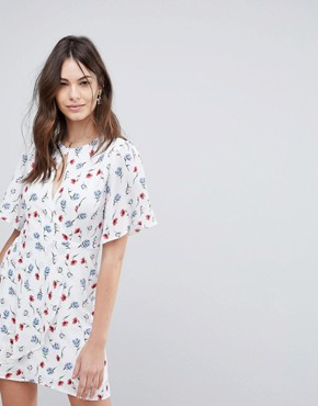 photo Wrap Front Tea Dress in All Over Floral Print by Fashion Union, color White Multi - Image 1