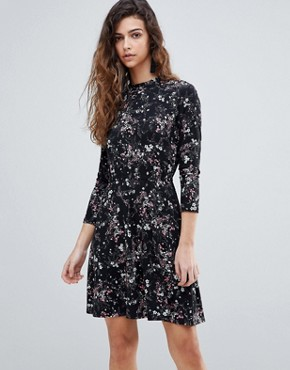 photo Ditsy Floral Print Skater Dress by Warehouse, color Black Print - Image 1