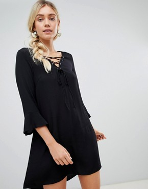 photo Lace Up Front Smock Dress by Lunik, color Black - Image 1