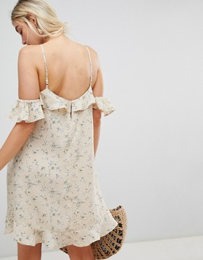 photo Dress with Cold Shoulder in Ditsy Floral Print by Lunik, color Frosted Almond - Image 2