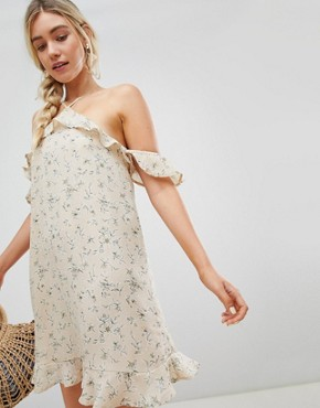 photo Dress with Cold Shoulder in Ditsy Floral Print by Lunik, color Frosted Almond - Image 1