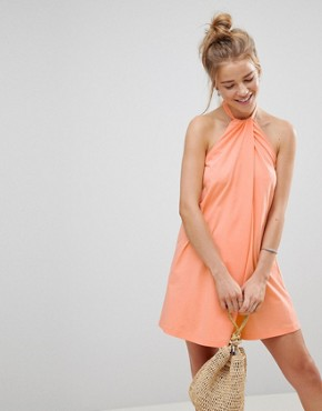 photo Twist Halterneck Swing Sundress by ASOS, color Peach - Image 1