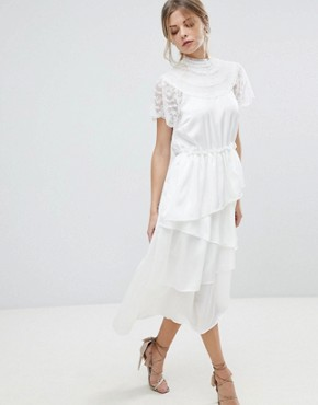photo High Neck Lace Midi Dress with Asymetric Hem by Y.A.S, color White - Image 1