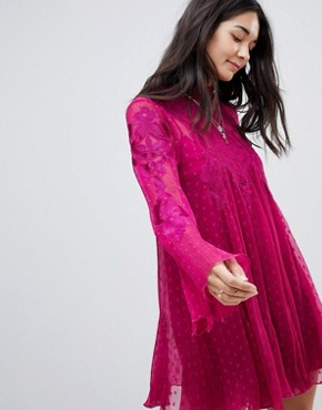 photo Cocquet Sheer Mini Dress by Free People, color Raspberry - Image 1