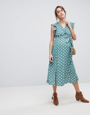 photo Sleeveless Midi Dress with Flutter Sleeves in Polka Dot by Glamorous Bloom, color Green Polka Dot - Image 1
