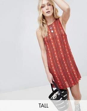 photo Sleeveless Shift Dress with Tie Back in Tile Print by Glamorous Tall, color Red Batik Border - Image 1