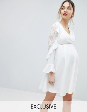 photo Wrap Front Skater Dress with Ruffle Sleeve Detail by Queen Bee, color Ivory - Image 1