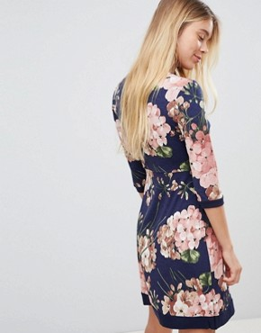 photo Floral Print Wrap Front Skater Dress with Tie Belt by Gilli, color Navy - Image 2