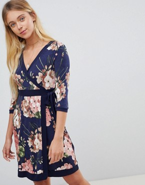 photo Floral Print Wrap Front Skater Dress with Tie Belt by Gilli, color Navy - Image 1