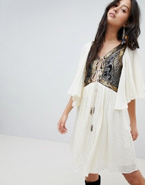 photo Moonglow Embellished Mini Dress by Free People, color Ivory - Image 1