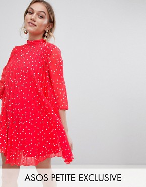 photo Pleated High Neck Mini Dress in Star Print by ASOS DESIGN Petite, color Red - Image 1