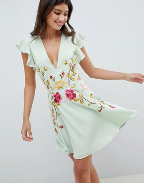 photo Embroidered Skater Mini Dress with Cut Out Sides by ASOS DESIGN, color Pastel Green - Image 1