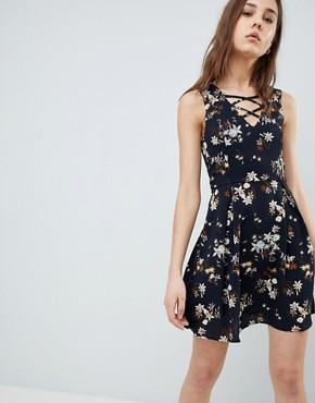 photo Floral Skater Dress with Lace Up Detail by QED London, color Navy - Image 1