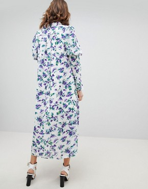 photo Maxi Smock Dress with Ruffle Layer in Shrinking Violet Floral by Sister Jane, color White Floral - Image 2
