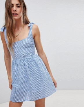 photo Sun Dress with Tie Shoulders in Mini Gingham by Emory Park, color Blue - Image 1