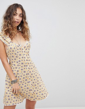 photo Cross Back Button Front Tea Dress in Ditsy Floral by Kiss the Sky, color Pale Mustard - Image 2