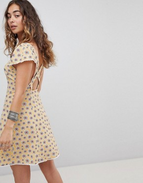 photo Cross Back Button Front Tea Dress in Ditsy Floral by Kiss the Sky, color Pale Mustard - Image 1