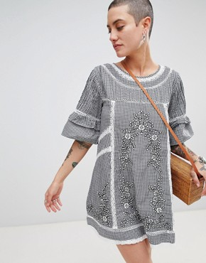 photo Sunny Day Embroidered Shift Dress by Free People, color Black - Image 1