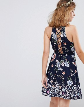 photo Mini Dress with Lattice Back in Mixed Floral Print by Sisters of the Tribe Petite, color Black Floral - Image 2