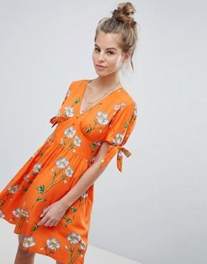 photo Tea Dress with Tie Sleeves in Daisy Print by Wednesday's Girl, color Orange Floral - Image 1
