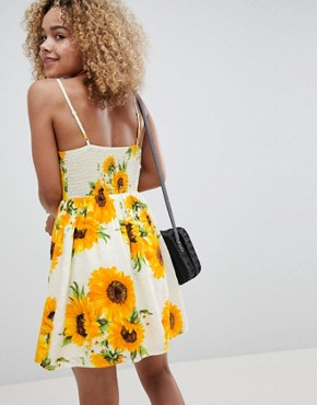 photo Mini Cami Skater Dress in Sunflower Print by Sisters of the Tribe Petite, color Lemon Floral - Image 2