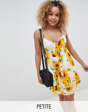 photo Mini Cami Skater Dress in Sunflower Print by Sisters of the Tribe Petite, color Lemon Floral - Image 1