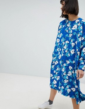 photo Trapeze Dress in Floral Print by Weekday, color Blue With Print - Image 1