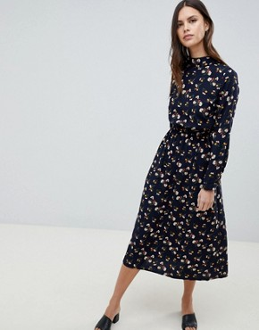 photo Long Sleeve Floral Maxi Dress by Uttam Boutique, color Navy - Image 1