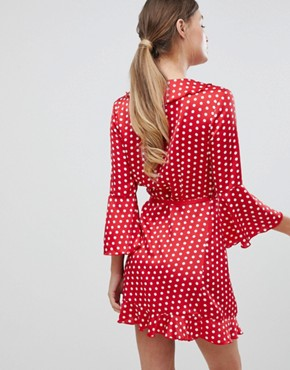 photo Printed Ruffle Wrap Dress with Fluted Sleeve by Outrageous Fortune, color Red Polka - Image 2