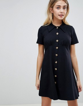 photo Polo Shirt Dress with Tortoiseshell Buttons by ASOS DESIGN, color Black - Image 1