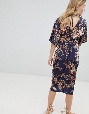 photo Kimono Sleeve Midi Dress with Knot Front Detail in Floral Print by Hope & Ivy, color Navy Base Leaf - Image 2