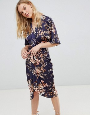 photo Kimono Sleeve Midi Dress with Knot Front Detail in Floral Print by Hope & Ivy, color Navy Base Leaf - Image 1