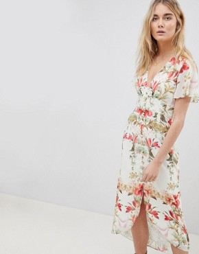 photo Button Front Flutter Sleeve Midi Dress in Mirrored Floral Print by Hope & Ivy, color White Print - Image 1
