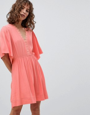 photo Skater Dress with Flutter Sleeve by Suncoo, color Coral - Image 1