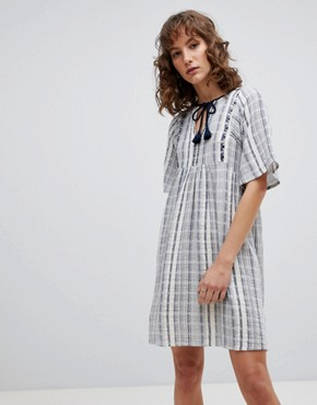 photo Striped Smock Dress by Suncoo, color Blue - Image 1
