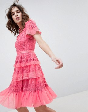 photo High Neck Layered Mini Dress with Ruffle Sleeves in Hot Pink by Needle & Thread, color Hot Pink - Image 1