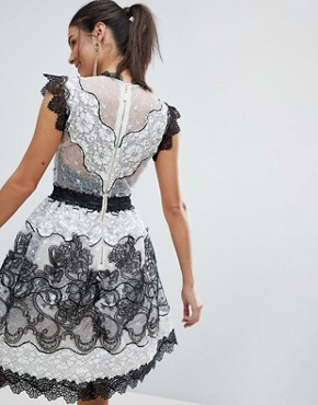 photo Monochrome Lace Mini Dress by Bronx and Banco, color Black - Image 2