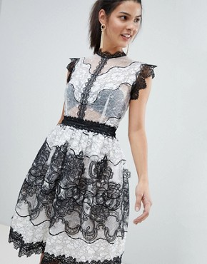 photo Monochrome Lace Mini Dress by Bronx and Banco, color Black - Image 1