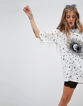 photo Oversized T-Shirt Dress in Sunburst Print by Motel, color Cream With Black Print - Image 1
