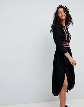 photo Floral Embroidered Midi Dress by Free People, color Black - Image 1
