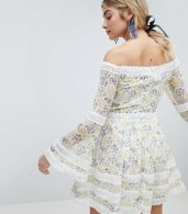 photo Allover Floral Bardot Skater Dress with Fluted Sleeve Detail by Dolly & Delicious, color Multi Floral - Image 2