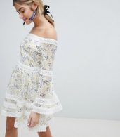 photo Allover Floral Bardot Skater Dress with Fluted Sleeve Detail by Dolly & Delicious, color Multi Floral - Image 1