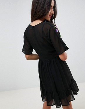 photo Tiered Mini Dress with Floral Embroidery by ASOS DESIGN, color Black - Image 2