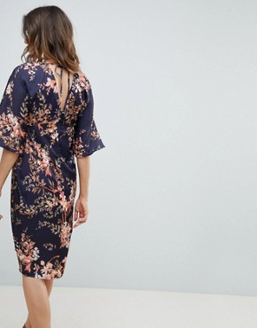 photo Kimono Sleeve Midi Dress with Tie Belt Detail in Floral Print by Hope & Ivy Maternity, color Navy Base Leaf - Image 2