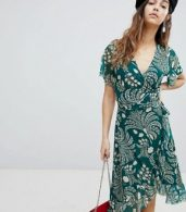 photo Printed Wrap Ruffle Dress by Soaked in Luxury, color Storm Green - Image 1